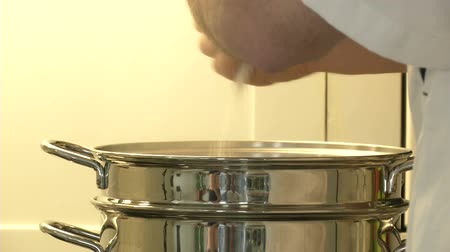 cooking pots : Chef pouring salt in pot full of boiling water
