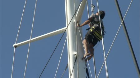 prestigious : Sailors climbs on the mast of a sailing boat for regatta during Perini Navi Cup on August 30 2013 in Porto Cervo Italy Stock Footage