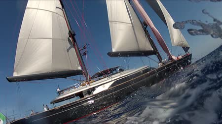 парусный спорт : Luxury sailing yacht navigates during Perini Navi Cup regatta Стоковые видеозаписи