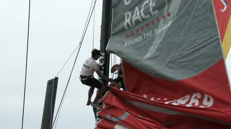 rhode : Sailors climb on the mast of Dongfeng During the Volvo Ocean Race on May 16, 2015 in Newport, RI, USA Stock Footage