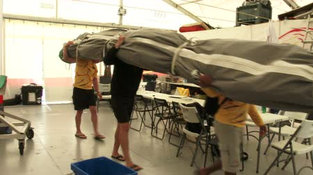 rhode : Sailors carry sail from race village During Volvo Ocean Race