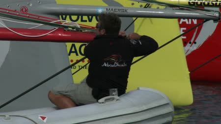 rhode : Abu Dhabi racing team sailor fixes bow of the boat During the Volvo Ocean Race on May 16, 2015 in Newport, RI, USA Stock Footage