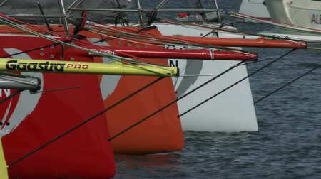 rhode : Detail of the bows of the Volvo Ocean Race sailing boats docked on May 16, 2015 in Newport, RI, USA Stock Footage
