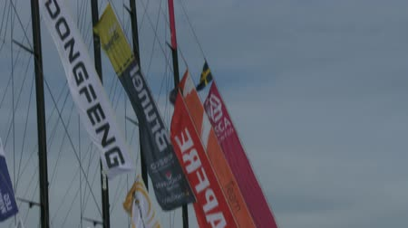 гоночный : Flags wave on the Volvo Ocean Race sailing boats docked on May 16, 2015 in Newport, RI, USA