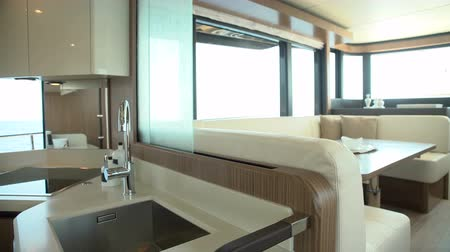 kitchen furniture : Sliding door closing between kitchen and living room on a luxury yacht Stock Footage