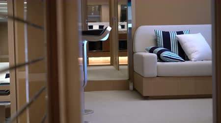 мебель : Mirrors, sofa and wooden furniture in the master cabin on a luxury yacht