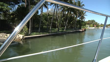 mariner : On board view of a boat navigating slowly in a canal in Miami Stock Footage