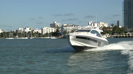 mariner : Luxury yacht navigates in front of Miami Stock Footage
