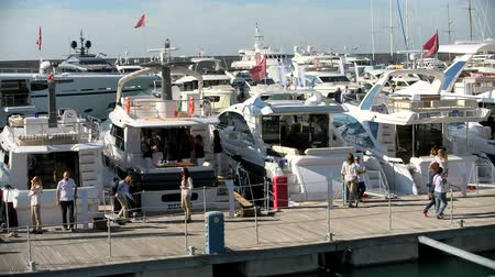 pier : People attend Genoa Boat Show, the most important exhibition of boats in Italy Stock Footage