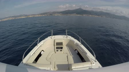 On board the front view of the bow a fishing boat navigating fast Wideo
