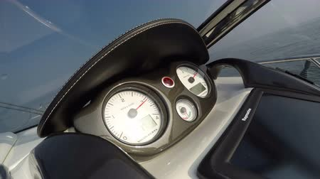 Detail of the dashboard of a boat accelerating fast, with view of the rev counter Wideo