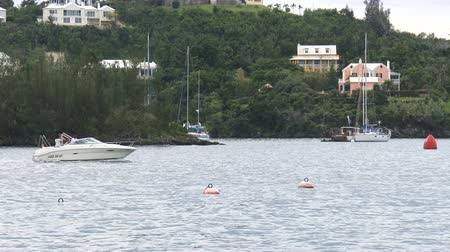 bermudas : Boat navigates in front of the Bermuda yacht club during Americas Cup sailing series