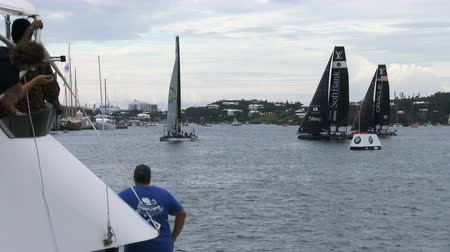 yat yarışı : Americas Cup AC45 wingsail catamarans getting ready for regatta in Hamilton, Bermuda, during Americas Cup sailing series
