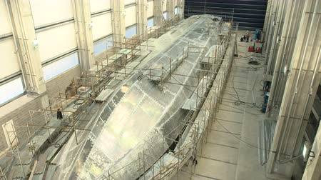 Aluminum hull of a maxi yacht being built in a shipyard