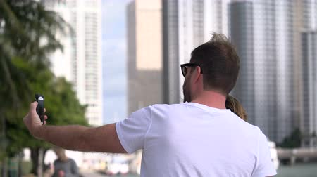 metropolitan area : Tourists take a selfie along the sea in Miami Stock Footage