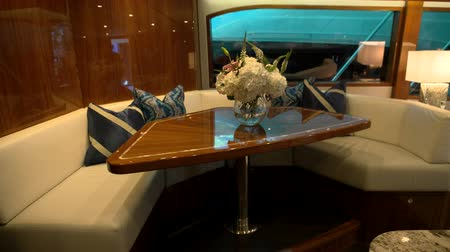 Dinner area in main salon is a luxury fishing boat docked in Miami during Miami International Boat Show Dostupné videozáznamy