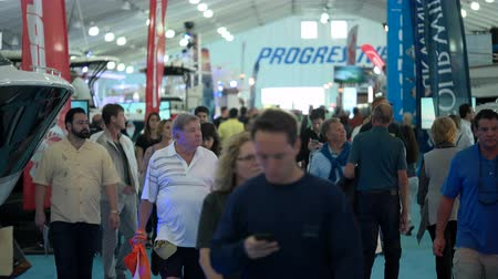 mariner : People attend Miami International Boat Show on February 13, 2016 in Miami