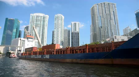 Cargo ship pulled along the canal in downtown Miami