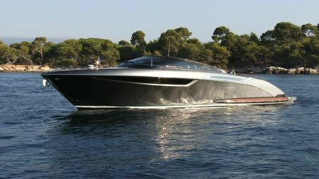 mükemmellik : Luxury Riva boat anchored during a Cannes yachting festival Stok Video