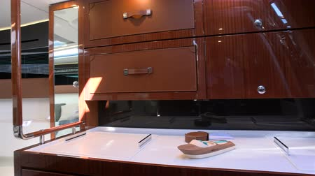 Kitchen and main cabin on a luxury vintage boat exhibited at the Cannes yachting festival