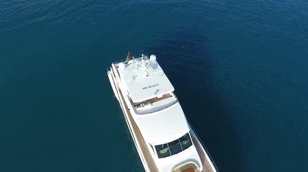 Rotating aerial view of luxury yachts on calm sea Wideo