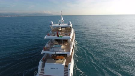 Aerial view of 110 feet long luxury yachts navigating slowly on calm sea Wideo
