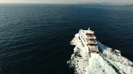 Aerial view of 110 feet long luxury yachts navigating fast on calm sea Wideo