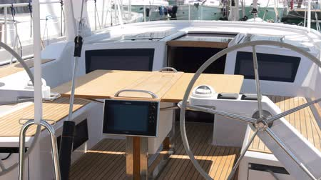 Cockpit of a sailing boat with wooden benches and table Wideo