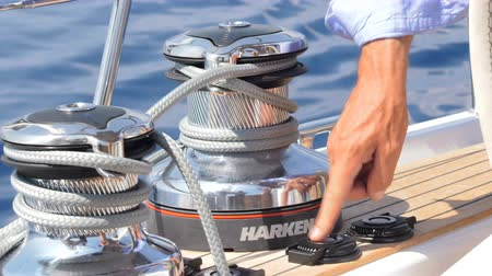 Electric winch pulling ropes on a sailing boat
