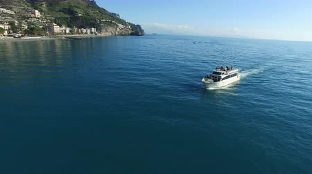 positano : Aerial view of a ferry transporting passengers off the coast of Amalfi, Italy