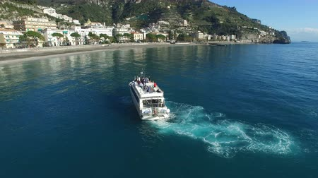 Aerial view of a ferry transporting passengers maneuvering off the coast of Amalfi, Italy