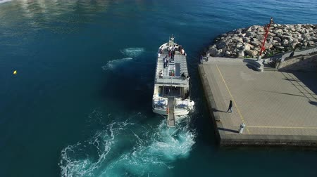 amalfi : Aerial view of a ferry transporting passenger docking at the entrance of a small port near Amalfi, Italy
