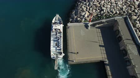 Aerial view of a ferry transporting passengers sailing off a small port near Amalfi, Italy Wideo