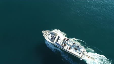 Aerial perpendicular view of ferry transporting passengers navigating off the coast of Amalfi, Italy