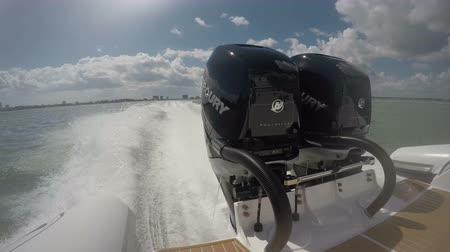 Powerful outboard engines on a RIB navigating at full speed in Fort Lauderdale