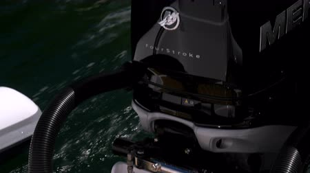 inner : Detail of a powerful outboard engine on a RIB navigating slowly Stock Footage
