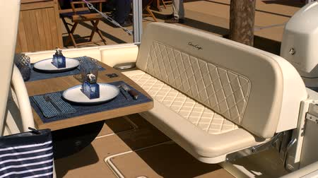 mariner : Sofa and small table on a luxury classic boat docked during Miami International Boat Show