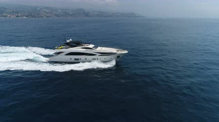 Aerial view of a luxury yacht navigating at the open sea.