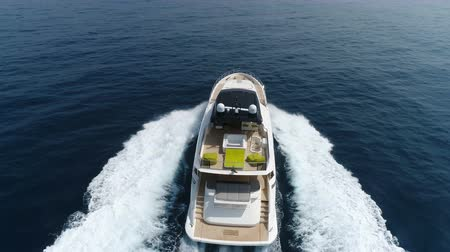 mükemmellik : Aerial top view of a luxury yacht navigating at the open sea. Stok Video
