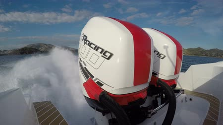 Mercury Verado racing 400 hp outboard engines on a rib navigating at full speed.