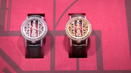Elegant watches exhibited at Corum booth at Baselworld watches and jewelry show in Basel, Switzerland.