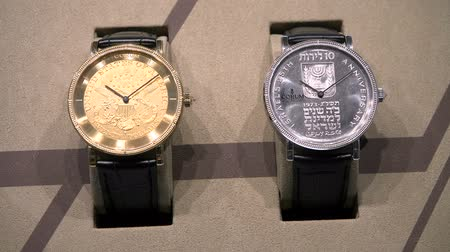 palestina : Watches made with special coins exhibited at Corum booth at Baselworld watches and jewelry show in Basel, Switzerland.