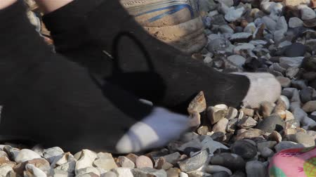 sock : Close Up Adult & Child Nosily Scraping Gravel with Shoes off Socks on (audio)