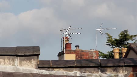 дымоход : Close Up of Chimney Pots Television Aerials & Roof Top Tiles  - Blue Sky Clouds