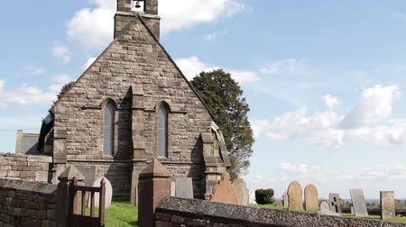churchyard : Lens Flare Beautiful Light Old Countryside Rural Church - Blue Sky Fluffy Clouds Stock Footage