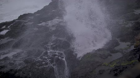 Slow-Motion footage of water shooting up through the rock wall at Depoe Bay, OR during a stormy day. Dostupné videozáznamy