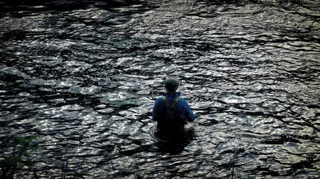 fishermen : Fisherman casts his line in the river