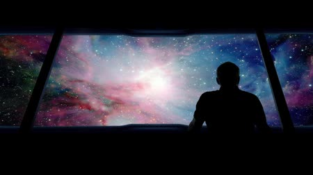 astronauta : Astronaut Looks Out Traveling Into Vast Galaxy Vídeos