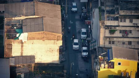 tin roofs : Road Through Poor Area Of City At Sunset Stock Footage