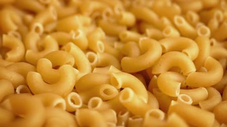 pieces of cheese : Macaroni Pasta Pieces Rotating Closeup